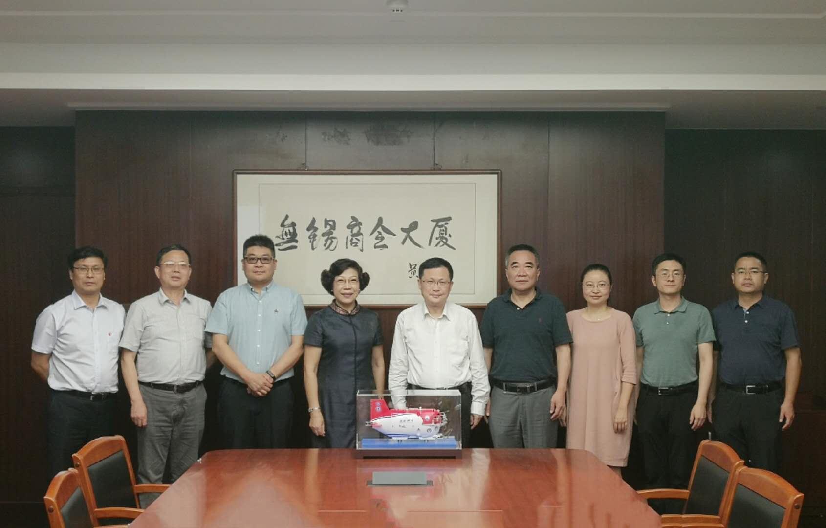 中国船舶集团有限公司第七O二研究所何春荣所长一行莅临我会考察
